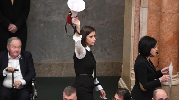 One member of parliament brandishes an air horn in parliament following the vote.