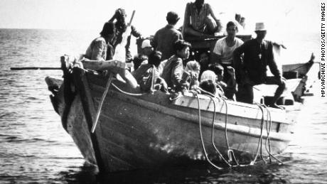 Refugees from southeast Asia, known as boat people, arriving in the USA, circa 1975.