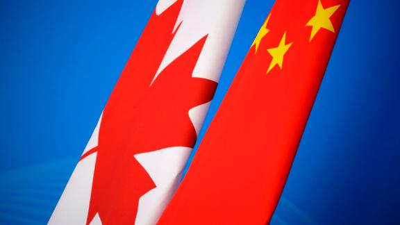 The flags of Canada and China are placed for first China-Canada economic and financial strategy dialogue in Beijing on November 12, 2018. (Photo by JASON LEE / POOL / AFP)        (Photo credit should read JASON LEE/AFP/Getty Images)