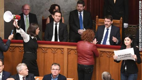 Opposition lawmakers protest in parliament after Wednesday's vote.