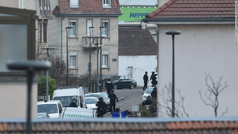 Members of the French police special forces take part in an operation at the Neudorf neighborhood in Strasbourg.