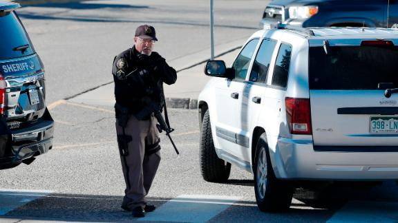 A member of the Jefferson County Sheriff's Office stands guard outside Columbine High School on Thursday in Littleton, Colorado.