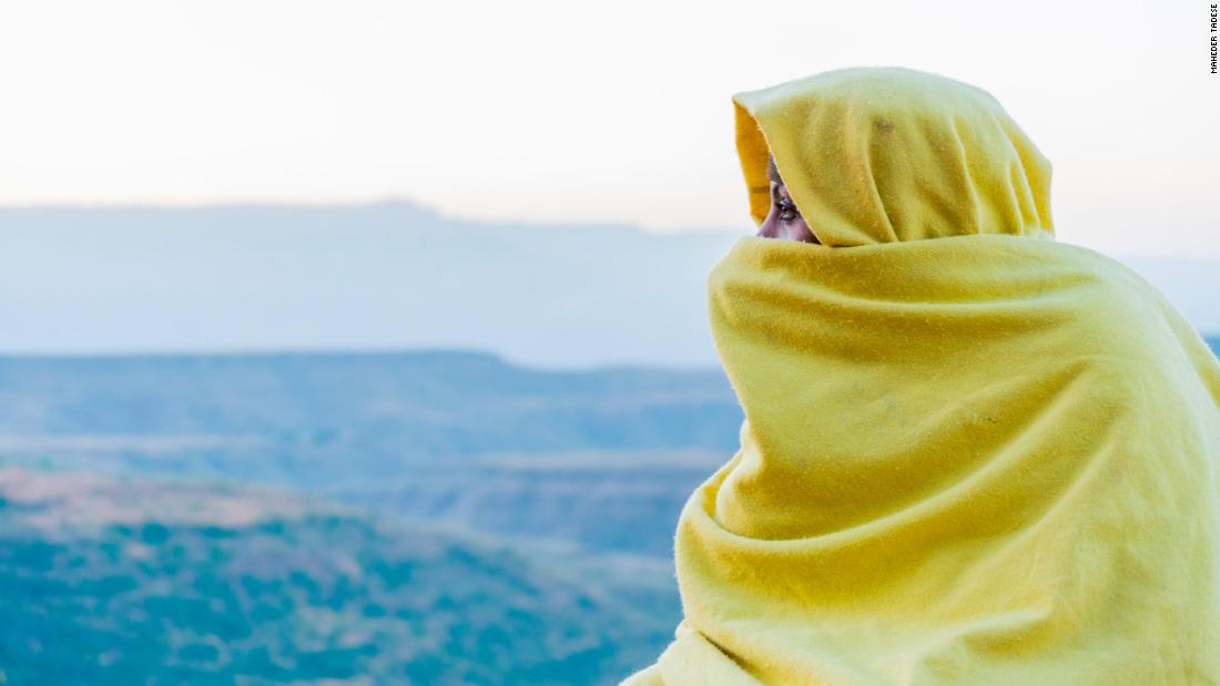 "<a href=""https://www.instagram.com/maile_tadese/"" target=""_blank"">Maheder Tadese</a> is an Ethiopian photographer who explores life across her country with striking images and thoughtful captions. In this 2015 image by Tadese in Lalibela, Ethiopia, a female monk, Woletemariam is shown praying at the top of one of the churches in Lalibela. She became a monk several years ago after being diagnosed with an illness."