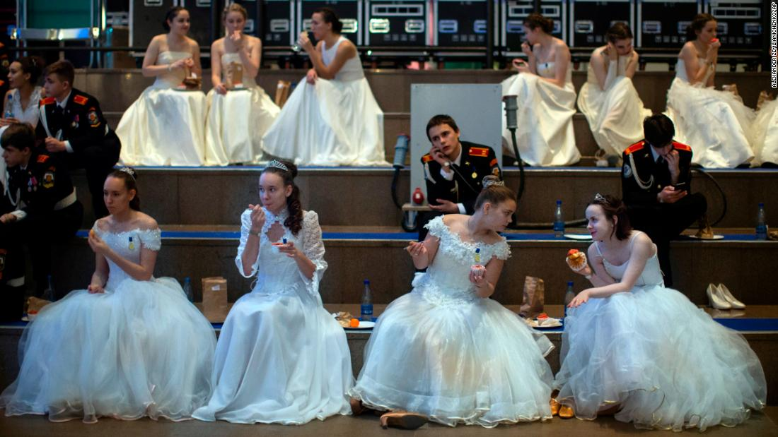 Military school students sit backstage during an annual ball in Moscow on Tuesday, December 11.
