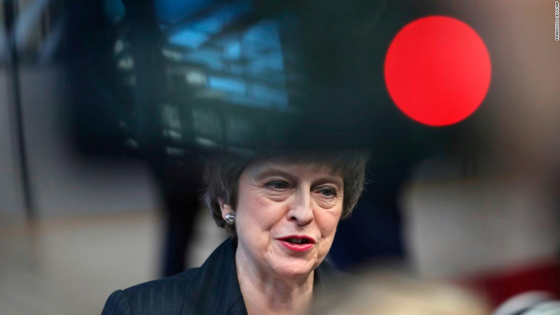 British Prime Minister Theresa May speaks with the media as she arrives for an EU summit in Brussels, on Thursday, December 13. The two-day summit will center on the Brexit negotiations after May survived a no-confidence vote by members of her own party over her handling of the Brexit deal.