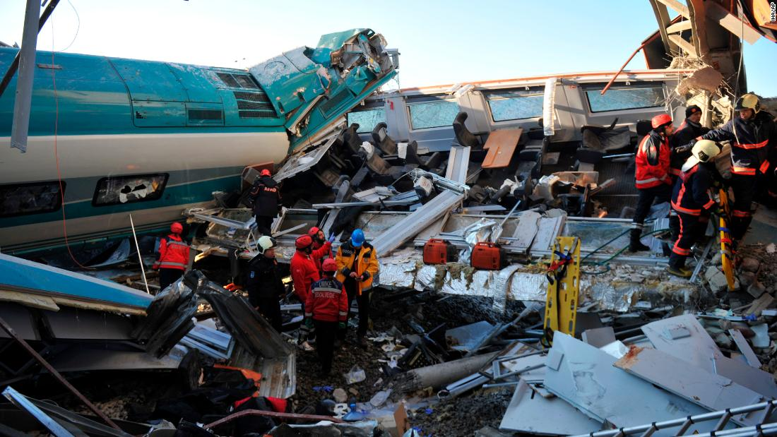Rescue services work at the scene of a train accident in Ankara, Turkey, on Thursday, December 13. A high-speed train crashed in the Turkish capital , killing at least nine people and injuring dozens more, according to the city's governor.