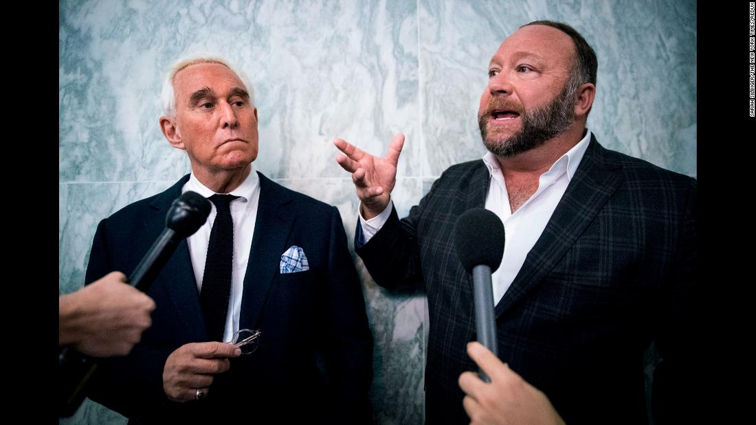 Roger Stone , left, the Republican political operative, and Alex Jones, the right-wing conspiracy theorist and talk show host, talk to reporters outside the House Judiciary Committee where Sundar Pichai, Google's chief executive, was testifying on Capitol Hill, on Tuesday December 11, 2018.