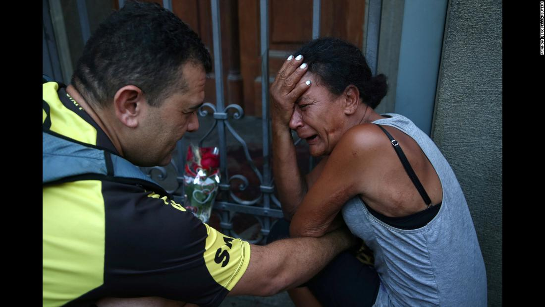 A woman is distraught after a shooting at a Catholic cathedral in Campinas, Brazil, on Tuesday, December 11.