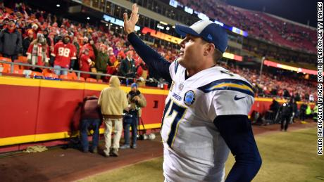 Chargers quarterback Philip Rivers waves to Kansas City Chiefs fans after his team defeated the Chiefs at Arrowhead Stadium.