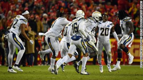 The Chargers celebrate after their comeback win against the Chiefs on Thursday. With the win, the Chargers are back in the playoffs for the first time since the 2013 season.