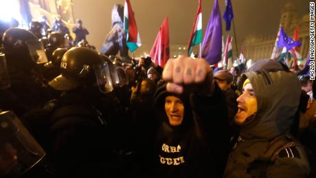 Demonstrators denounce recent legislative measures introduced by the government of Hungarian Prime Minister Viktor Orban outside Parliament on Thursday in Budapest.