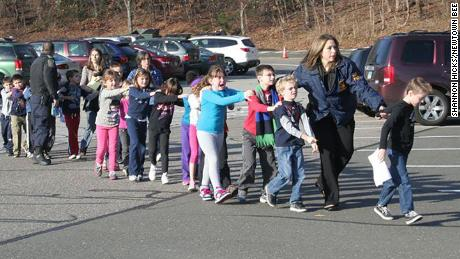 Children are led away from Sandy Hook Elementary on December 14, 2012.