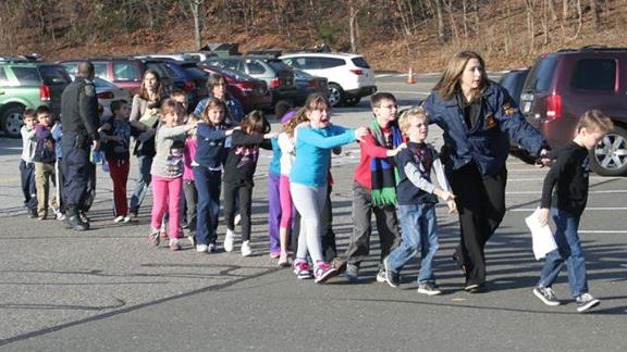 Children are led away from Sandy Hook Elementary on December 14, 2012.