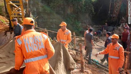 Rescue workers at the site of a mine that collapsed and flooded in India's northeastern Meghalaya state.
