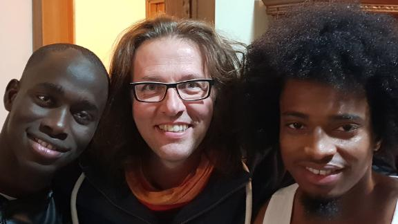 Father Luca Favarin with migrants from his community in Padua, northern Italy