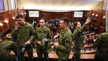 Members of the Kosovo Security Force attend the session at Kosovo parliament where lawmakers voted to create an army.