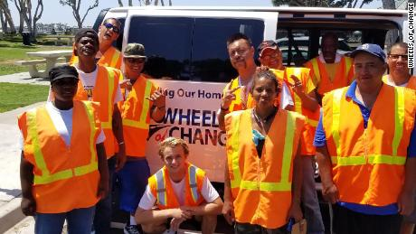 "San Diego teen Kevin Barber (center) poses with his ""Wheels of Change"" crew."