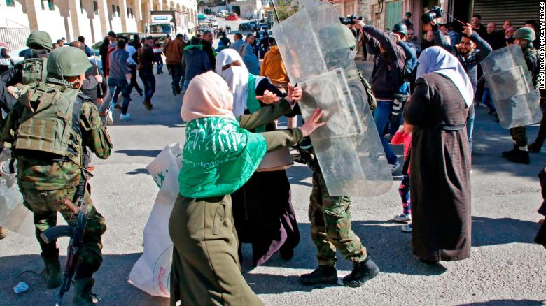 Palestinian security forces clash with Hamas supporters in Hebron on Friday.