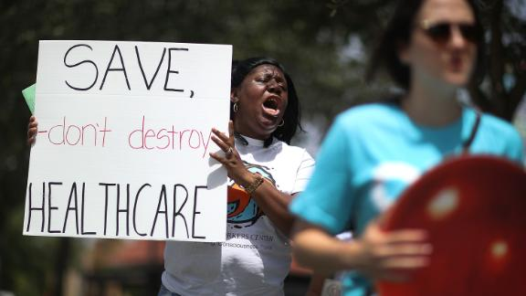 MIAMI, FL - AUGUST 03: Trenise Bryant joins others for a protest in front of the office of Rep. Carlos Curbelo (R-FL) on August 3, 2017 in Miami, Florida. The protesters are asking for Rep. Curbelo to explain his vote on the Affordable Care Act and to take a stand against what they say is 'President Donald Trump's budget that slashes Medicaid by more than $800 billion and weakens the social safety net for more than 113,000 residents in Rep. Curbelo's district who rely on Medicaid. '  (Photo by Joe Raedle/Getty Images)