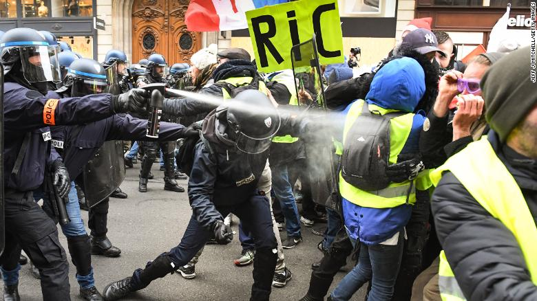 Police use tear gas on protesters at the Place de l'Opera in Paris on December 15.