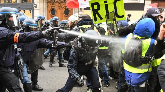 Police use tear gas on protesters at the Place de l