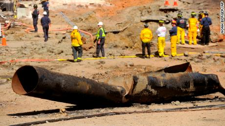 A natural gas line lies broken on a San Bruno, California, road after a massive explosion September 11, 2010. PG&E was placed on probation and given massive fines related to the blast.