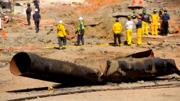 In this 2010 photo, a natural gas line lies broken on a San Bruno, Calif., road after a massive explosion. A federal jury found Pacific Gas & Electric Co., California