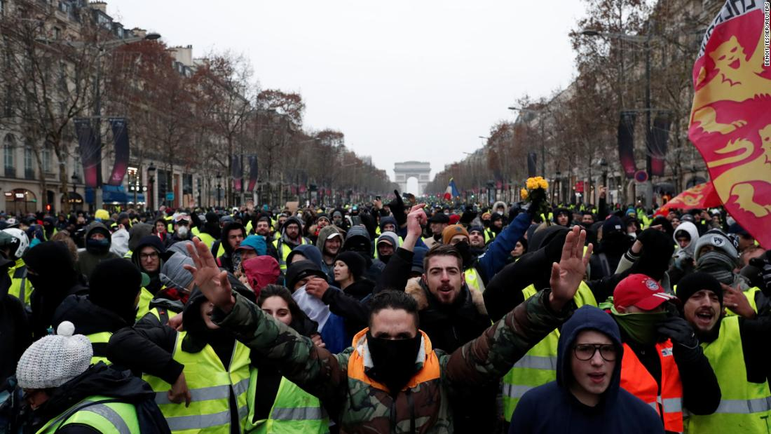 Protesters take part in a demonstration on December 15 in Paris.