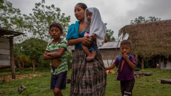 Claudia Maquin, 27, walks with her three surviving children in Raxruha, Guatemala, Saturday.