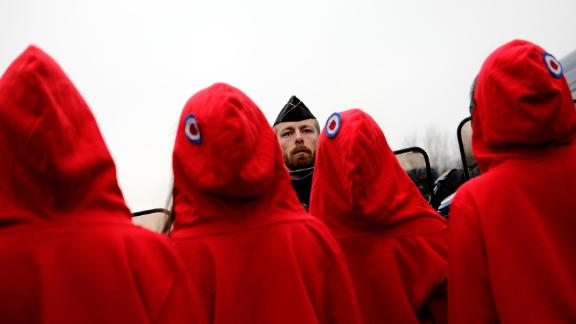 Activists dressed like Marianne, the symbol of the French Republic, face riot police on December 15 in Paris.