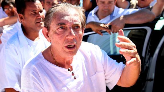 Brazilian spiritual healer Joao Teixeira de Faria, also known as John of God, arrives at the Dom Inacio de Loyola Center on Wednesday.