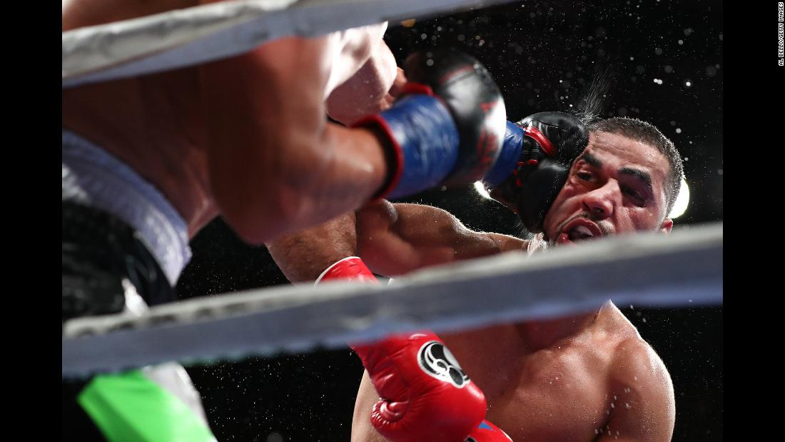 Sadam Ali is punched in the face during a welterweight fight against Mauricio Herrera at Madison Square Garden on December 15 in New York City. Ali won the fight by unanimous decision.