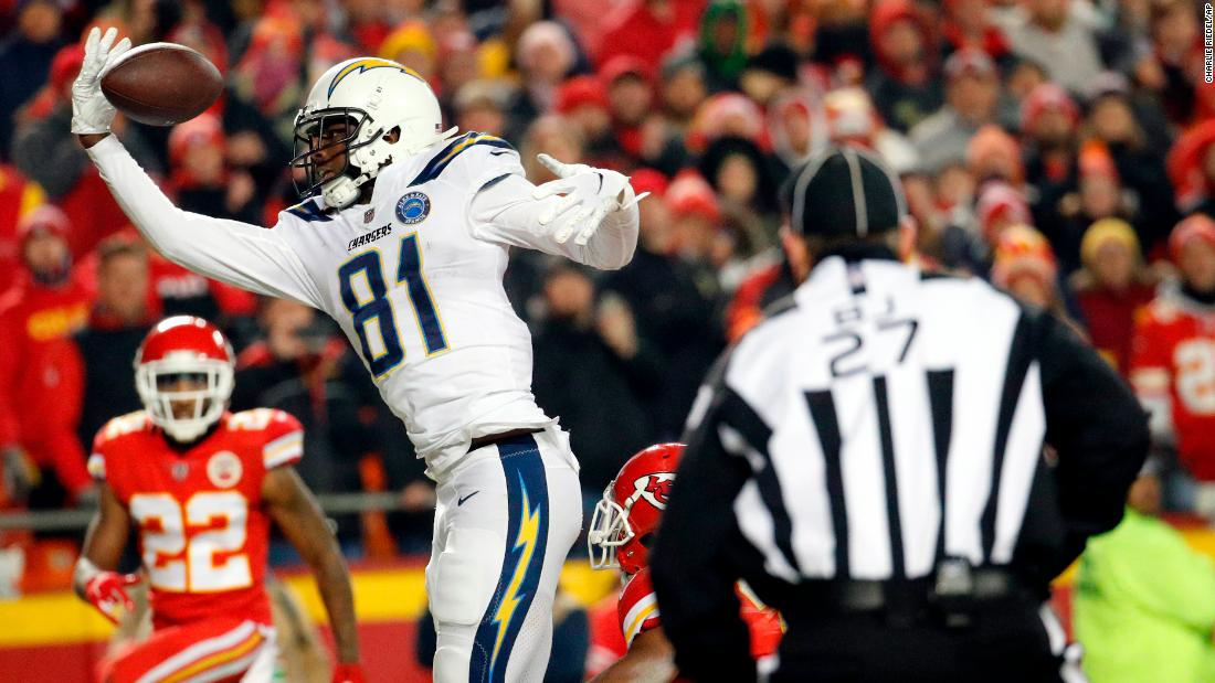 Kansas City Chiefs cornerback Kendall Fuller, lower right, is called for pass interference against Los Angeles Chargers wide receiver Mike Williams during the second half of the game in Kansas City on Thursday, December 13.