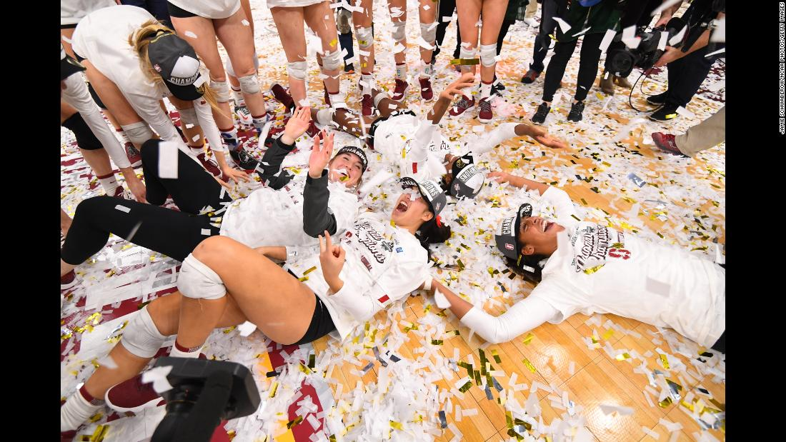 Stanford players celebrate with confetti after winning the Division I Women's Volleyball Championship on December 15 in Minneapolis, Minnesota. Stanford won the championship match in five sets over Nebraska.