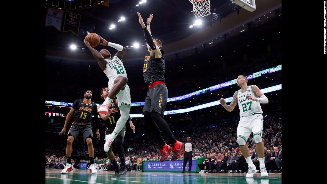 Boston Celtics guard Terry Rozier goes up for a shot against Atlanta Hawks center Alex Len during the second half of an NBA game at TD Garden on December 14 in Boston, Massachusetts. Boston won the game 129-108.