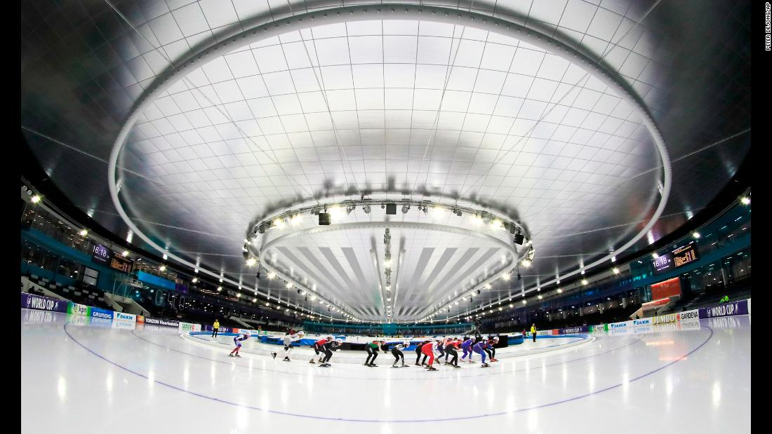 Competitors skate around the Thialf ice arena during the starting event for the women's semifinal World Cup speed skating competition in Heerenveen, Netherlands on Friday, December 14.