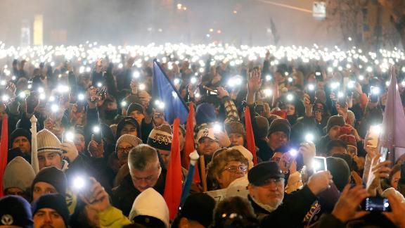 Demonstrators  stand outside Hungary