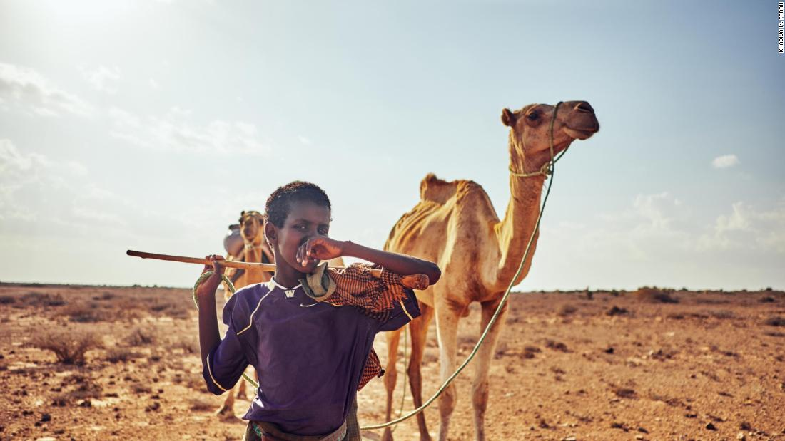 "In Nugal, Somalia, <a href=""https://www.kmfarah.com/about"" target=""_blank"">Farah</a> highlights Mahad Abdulaziz walking his father's camels from Biyo-Cade to their home several miles away. Biyo-Cade is a secluded village located on the bottom of a dried river valley."