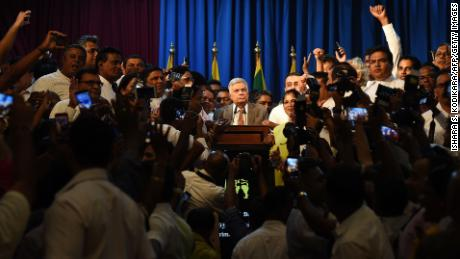 Sri Lanka's Prime Minister Ranil Wickremesinghe speaks to supporters at the prime minister's official residence in Colombo on December 16.