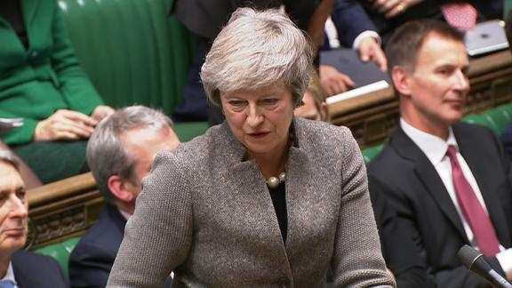 Theresa May announced Monday that she would reschedule the vote on her Brexit plan for the week of January 14.