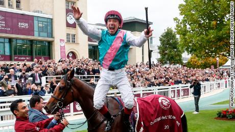 Frankie Dettori celebrates after Enable wins the Prix de l'Arc de Triomphe at Chantilly in 2017.