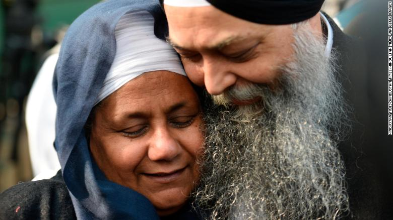 Nirpreet Kaur, an eyewitness to the 1984 Sikh massacre, is seen with AAP leader Jarnail Singh outside the Delhi High Court after  Kumar was sentenced to life imprisonment Monday.