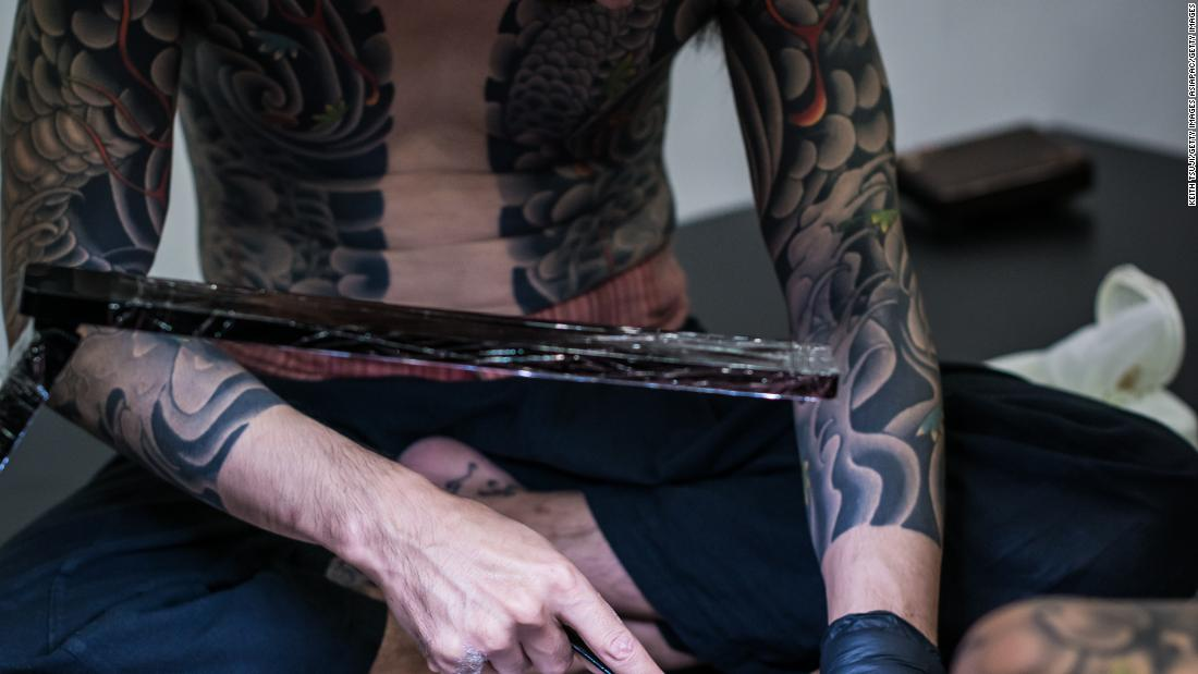 Tebori artists use rods to manually push ink beneath the top layers of skin, leaving a permanent mark for either decoration or, historically, punishment.