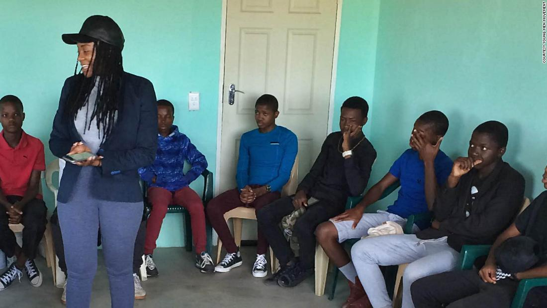A community member, Lebogang Mashishi, gives a talk to young boys about how to respect women during a meeting in Pankop, Mpumalanaga province in South Africa. Groups across the country such as Young Men's Movement and the global ManKind Project are seeking to support men through life and to actively mobilize them in fighting violence against women.