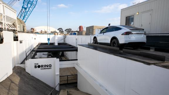 The Boring Company has dug an entrance to its test tunnel in a corner of SpaceX's parking lot.