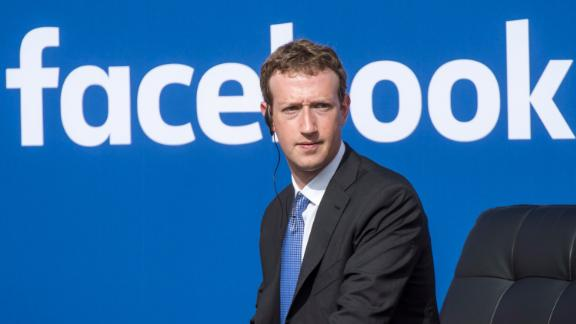 Mark Zuckerberg, chief executive officer of Facebook Inc., listens as Narendra Modi, India
