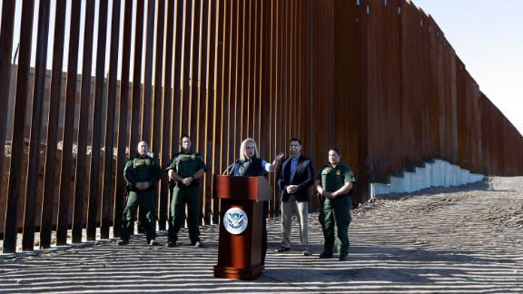 U.S. Department of Homeland Security Secretary Kirstjen Nielsen, center, speaks in front of a newly fortified border wall structure Friday, Oct. 26, 2018, in Calexico, Calif.