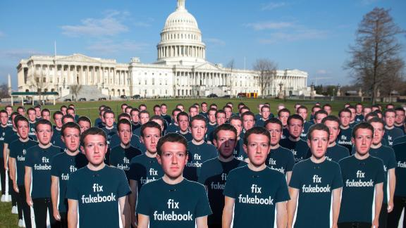 TOPSHOT - One hundred cardboard cutouts of Facebook founder and CEO Mark Zuckerberg stand outside the US Capitol in Washington, DC, April 10, 2018. - Advocacy group Avaaz is calling attention to what the groups says are hundreds of millions of fake accounts still spreading disinformation on Facebook. (Photo by SAUL LOEB / AFP)        (Photo credit should read SAUL LOEB/AFP/Getty Images)