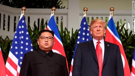 TOPSHOT - US President Donald Trump (R) poses with North Koreas leader Kim Jong Un (L) at the start of their historic US-North Korea summit, at the Capella Hotel on Sentosa island in Singapore on June 12, 2018. - Donald Trump and Kim Jong Un have become on June 12 the first sitting US and North Korean leaders to meet, shake hands and negotiate to end a decades-old nuclear stand-off. (Photo by SAUL LOEB / AFP)        (Photo credit should read SAUL LOEB/AFP/Getty Images)