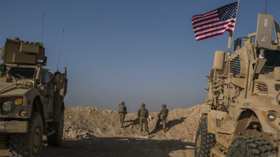 FILE -- U.S. Special Forces soldiers near Manbij, in northern Syria, on Feb. 7, 2018. President Donald Trump has ordered a rapid withdrawal of all 2,000 U.S. ground troops from Syria within 30 days, declaring the four-year American-led war against the Islamic State as largely won, officials said Wednesday, Dec. 19, 2018. (Mauricio Lima/The New York Times)